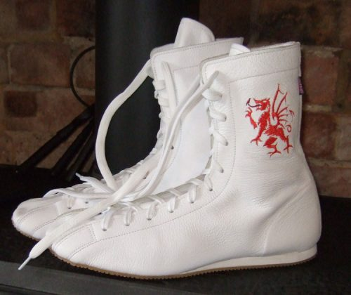 Minotaur White boxing boot with Welsh Dragon motif on left boot