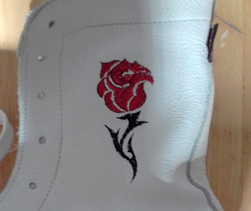 Minotaur White boxing boot with English Rose motif on left boot